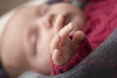 Close Up Of Hand Of Sleeping Newborn Baby Girl Stock Photos