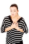 Woman having chest pain Stock Photos