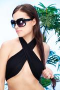 Woman with sun glasses holding hair Stock Photos