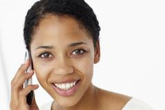 Young woman on phone - stock photo