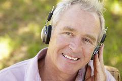 Senior man with headphone Stock Photos