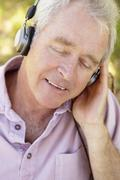 Senior man with headphone - stock photo