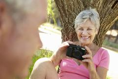 Senior woman with camera Stock Photos