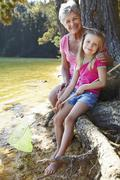 Woman and girl fishing together Stock Photos