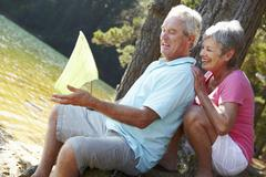 Senior couple fishing together - stock photo