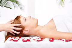 woman on head massage treatment - stock photo