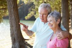 Senior couple at lake together Stock Photos