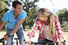 Young couple on country bike ride Stock Photos