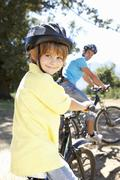 Little boy on country bike ride with dad Stock Photos