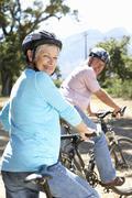 Senior couple on country bike ride Stock Photos