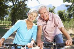 Senior couple on country bike ride Stock Photos