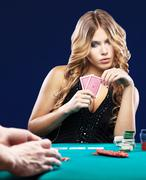 Woman doubt in gambling match Stock Photos
