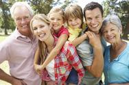 Stock Photo of Portrait multi-generation family outdoors