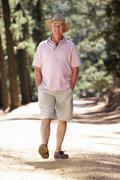 Senior man on country walk Stock Photos