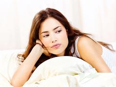woman lie in bed at home - stock photo