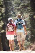 Senior couple on country walk - stock photo