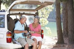 Senior couple on country picnic - stock photo