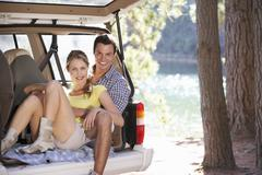 Young couple on day out in country - stock photo