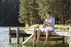 Young man fishing Stock Photos