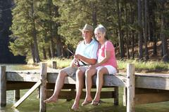 Senior couple fishing - stock photo