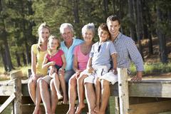 3 Generation family sitting by lake Stock Photos