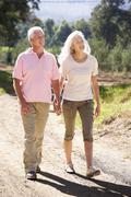 Senior couple on country walk Stock Photos