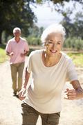 Senior couple on country run Stock Photos