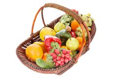 Basket with fruits and vegetables Stock Photos