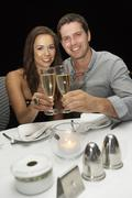 Young couple in restaurant Stock Photos