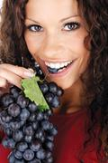 pretty girl eating grape - stock photo