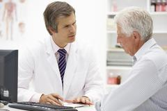 Doctor with senior patient Stock Photos
