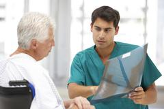 Senior patient with young doctor Stock Photos