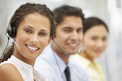 Businesswoman wearing headset Stock Photos