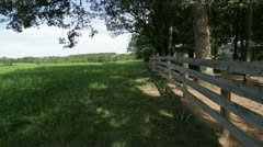 Walking Along Country Fence Stock Footage