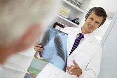 Young doctor with senior patient Stock Photos