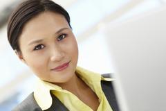 Young businesswoman using laptop Stock Photos