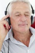 Senior man with headphones - stock photo
