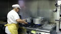 Chef Cooking in a italian seafood restauran Stock Footage