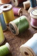 Cotton reels on table top Stock Photos