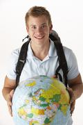 Young traveller with globe Stock Photos