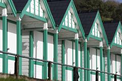 refurbished beach huts on south wales coast - stock photo