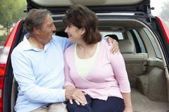 Senior Hispanic couple outdoors with car Stock Photos