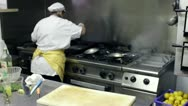 Stock Video Footage of Chef Cooking in a italian seafood restaurant