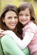 Portrait Hispanic mother and daughter - stock photo