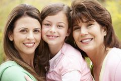 3 generations Hispanic women - stock photo
