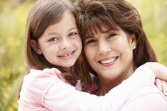 Stock Photo of Hispanic grandmother and granddaughter