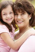 Hispanic grandmother and granddaughter - stock photo