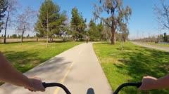 Riding Bicycle In El Dorado Regional Park, Long Beach CA Stock Footage