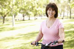 Senior Hispanic woman with bike Stock Photos