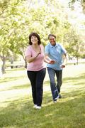 Senior Hispanic couple outdoors - stock photo